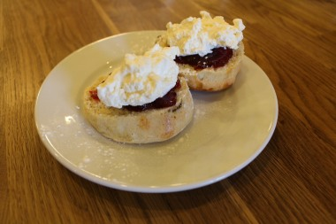 Scones with whipped cream and jam